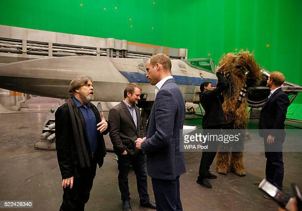 Prince William Duke of Cambridge speaks with US actor Mark Hamill as Prince Harry watches British actor John Boyega and Chewbacca during a visit to...