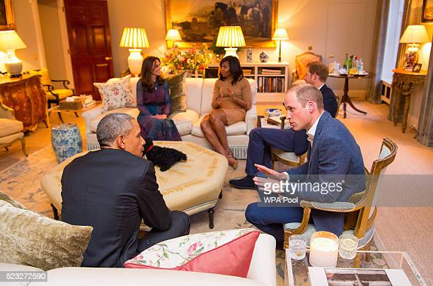Prince William, Duke of Cambridge speaks with US President Barack Obama as Catherine, Duchess of Cambridge speaks with First Lady of the United...