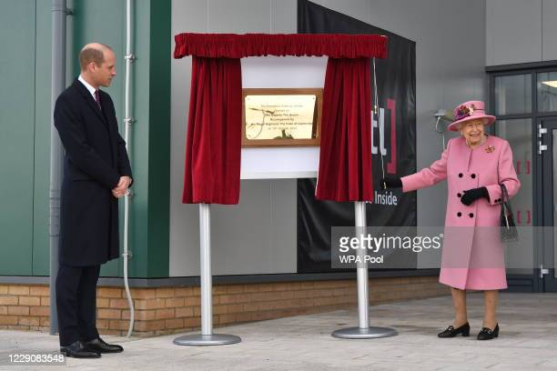 Prince William Duke of Cambridge stands by as Britain's Queen Elizabeth II unveils a plaque to officially open the new Energetics Analysis Centre at...