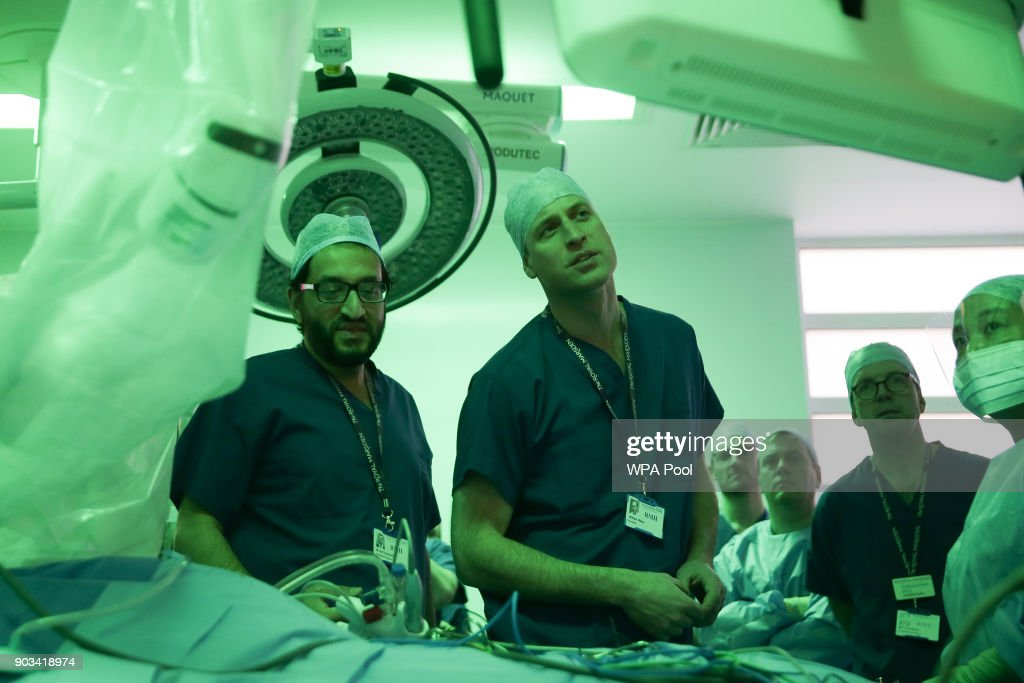 Prince William, Duke of Cambridge stands in the surgery theatre in front of a da Vinci XI machine prior to a highly complex robotic cancer operation to remove a tumour of the oesophagus at the junction between the heart, lungs and aorta, by lead surgeon Asif Chaudry (L) and colleague surgeon Myles Smith with patient Charles Ludlow, 63, during his visit to The Royal Marsden Hospital on January 10, 2018 in London, England. Prince William was visiting the hospital to view two pioneering robotic surgeries.