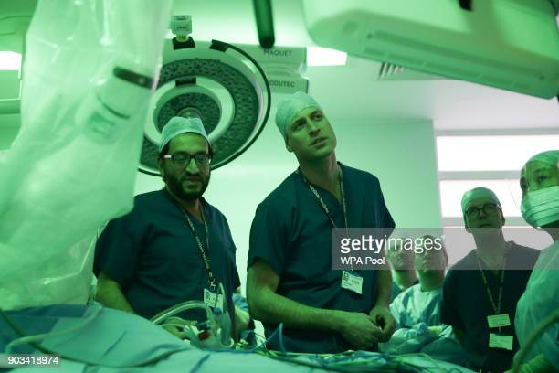 Prince William Duke of Cambridge stands in the surgery theatre in front of a da Vinci XI machine prior to a highly complex robotic cancer operation...