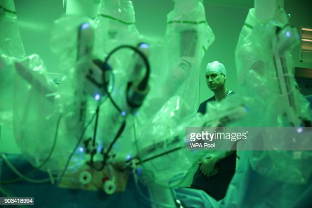 Prince William Duke of Cambridge stands in the surgery theatre next to a da Vinci XI machine prior to a highly complex robotic cancer operation to...