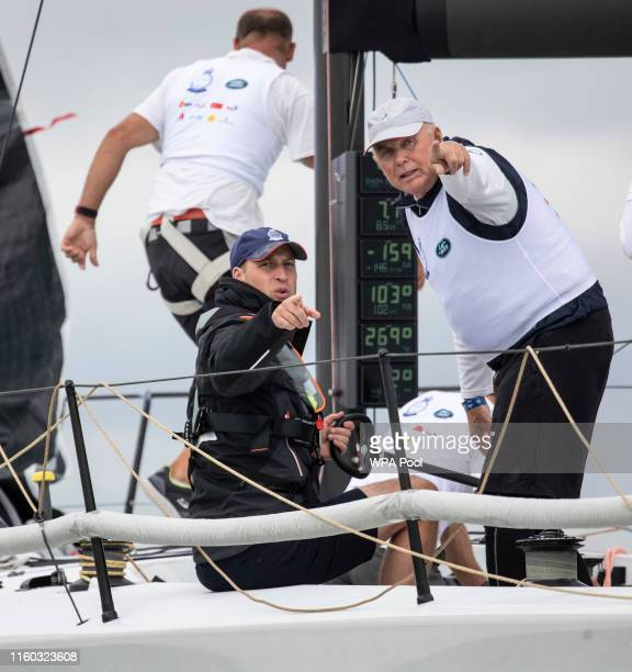 Prince William Duke of Cambridge steers the steers the child bereavement UK charity boat in the King's Cup regatta in the Solent on August 8 2019 at...