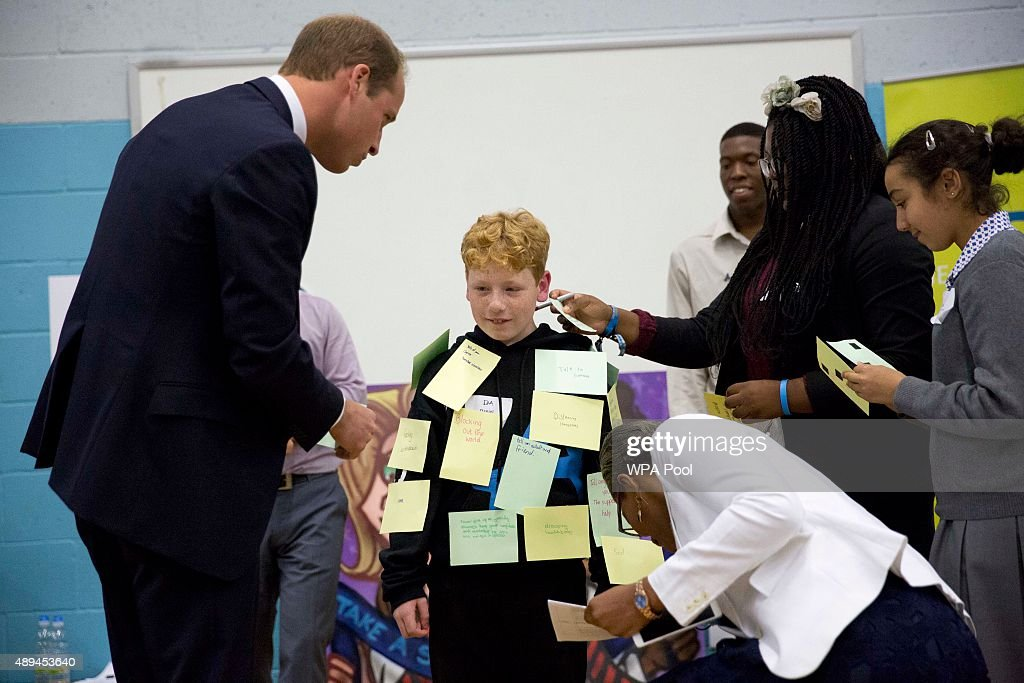 Prince William, Duke Of Cambridge sticks a post-it note on Daniel, aged 11 from Derbyshire, an anti-bullying ambassador as he takes part in a group exercise during his visit to Hammersmith Academy to support the Diana Award's Anti-bullying Campaign #Back2School on September 21, 2015 in London, England. The Diana Award was set up in memory of Prince William's mother Diana Princess of Wales.