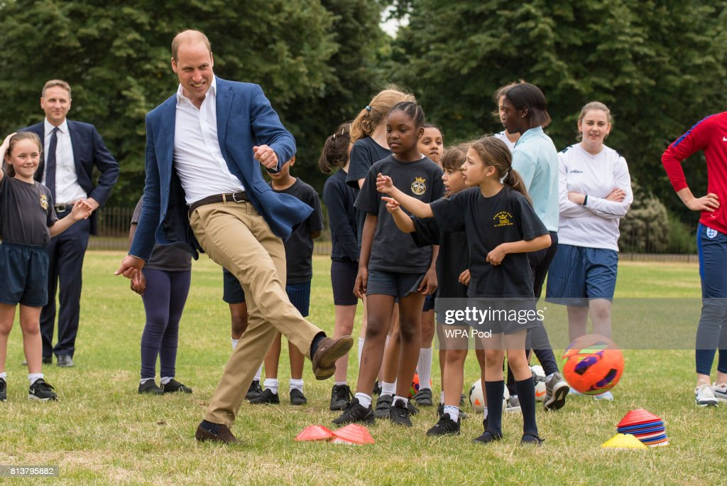 Prince William, Duke of Cambridge takes a shot at goal as he attends a kick-about with the Lionesses and local girls team from the Wildcats Girl' Football programme on July 13, 2017 in London, England.