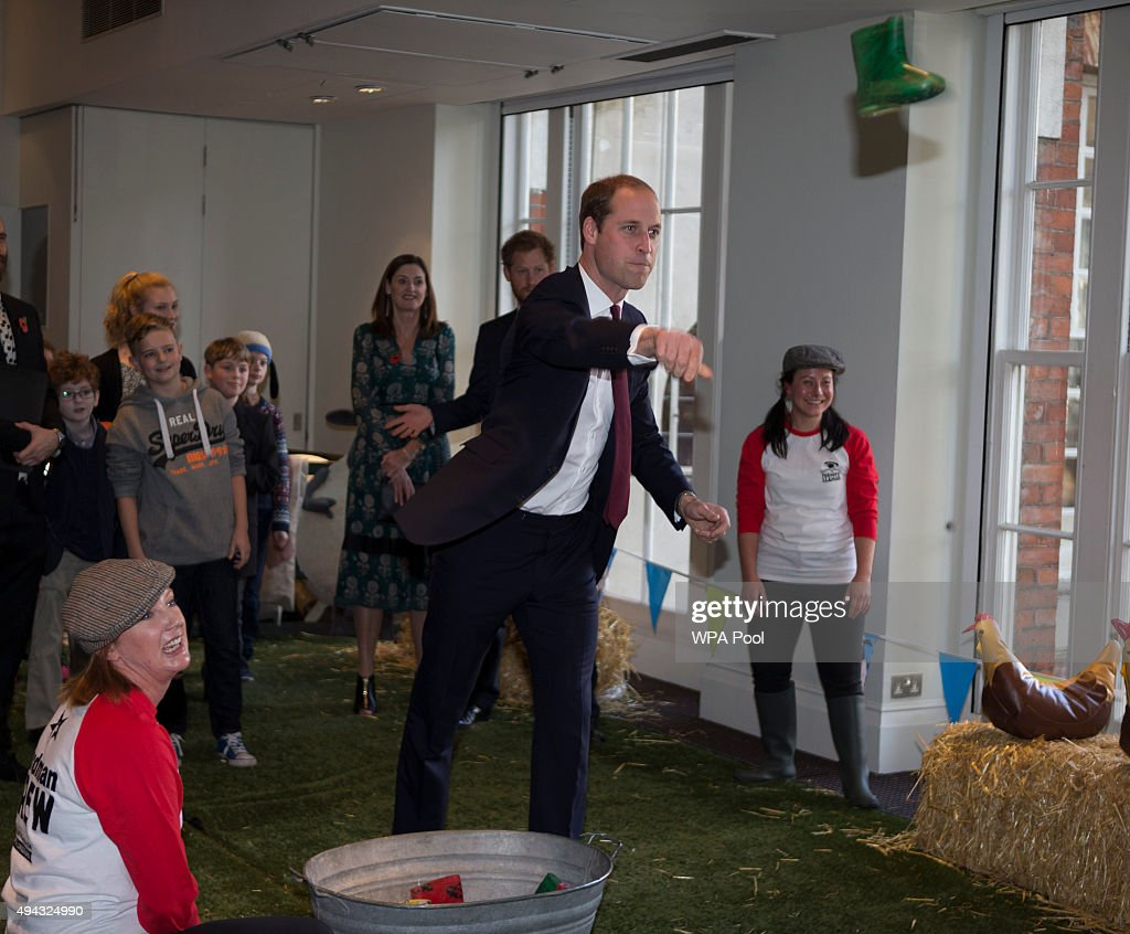 Prince William, Duke of Cambridge takes part in welly wanging, with children and representatives from charities and Aardman Animations, during a meeting of the Charities Forum at BAFTA on October 26, 2015 in London, United Kingdom.