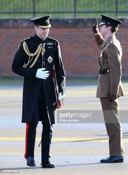 Prince William Duke of Cambridge takes the salute as he arrives to present service medals to First Battalion Irish Guards at Mons Barracks on...