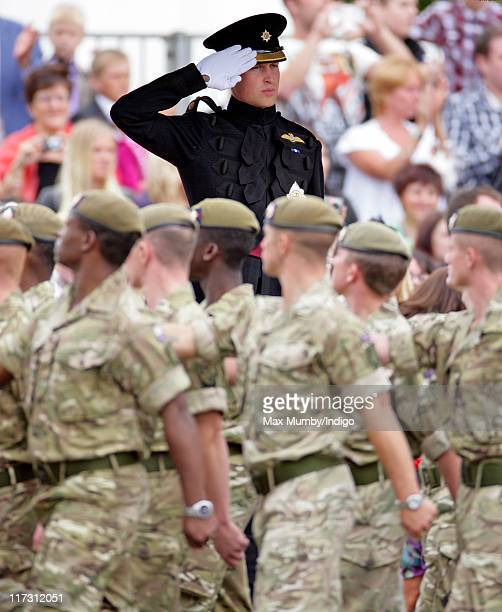 Prince William Duke of Cambridge takes the salute as he attends the Irish Guards Afghanistan Operational Medals Parade at Victoria Barracks on June...