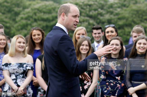 Prince William Duke of Cambridge talks to award recipients during a day of DofE presentations at Buckingham Palace on May 24 2018 in London England...