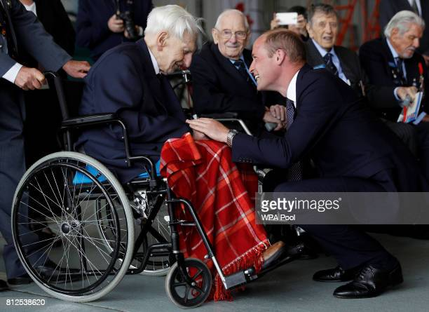 Prince William Duke of Cambridge talks to Battle of Britain veteran 99 year old Ken Wilkinson during a visit to The Battle Of Britain Memorial Flight...