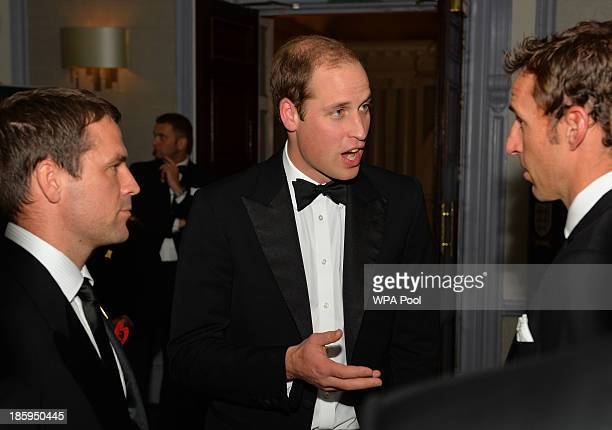 Prince William Duke of Cambridge talks to former England players Gareth Southgate and Michael Owen as he attends The Football Association's 150th...