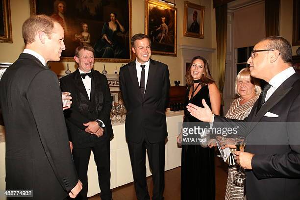 Prince William Duke of Cambridge talks to guests including Theo Paphitis and Peter Jones during the Tusk Trust conservation charity 25th Anniversary...