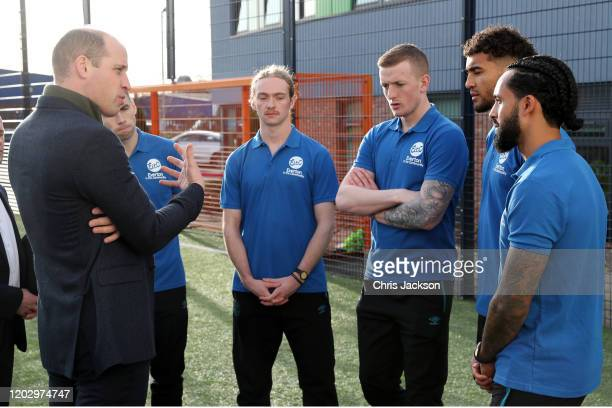 Prince William Duke of Cambridge talks to players of Everton FC Seamus Coleman Tom Davies Jordan Pickford Dominic CalvertLewin and Theo Walcott...