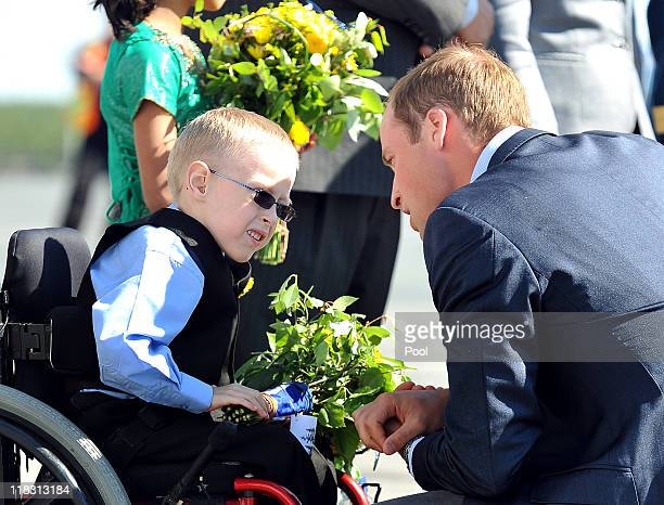 Prince William Duke of Cambridge talks to Riley Oldford before boarding a plane at Yellowknife Airport on July 6 2011 in Yellowknife Canada The newly...