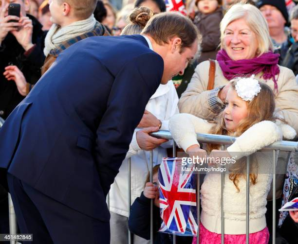 Prince William, Duke of Cambridge talks with a young girl during a walkabout as he arrives to officially open the Haven Point leisure centre on...
