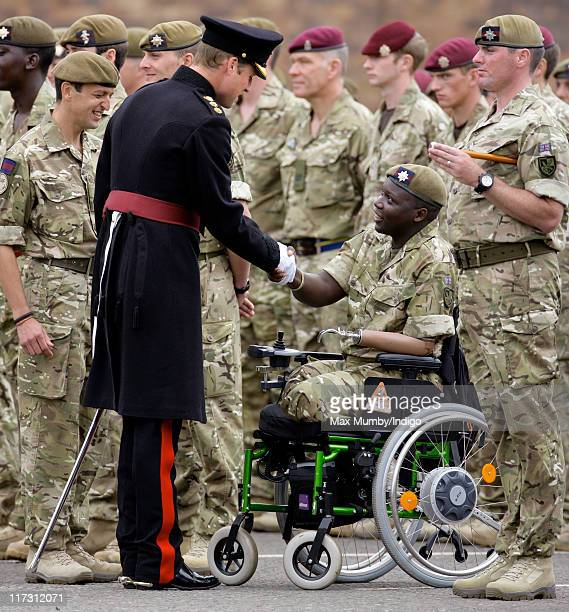 Prince William Duke of Cambridge talks with an injured soldier as he attends the Irish Guards Afghanistan Operational Medals Parade at Victoria...