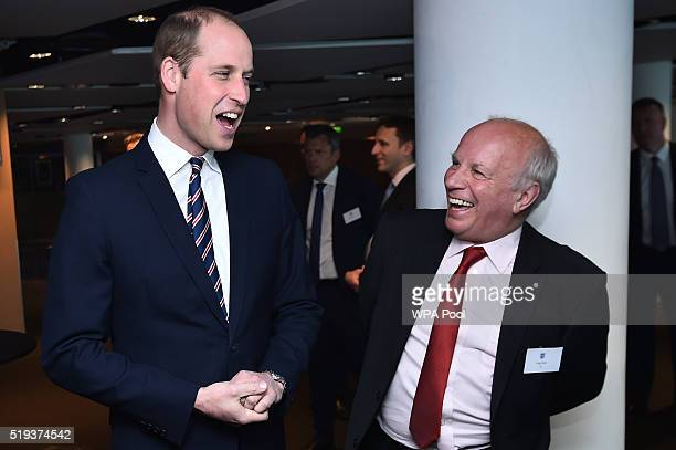 Prince William Duke of Cambridge talks with Chairman of the FA Greg Dyke at a reception as he arrives for a Council Lunch to celebrate the 10th...