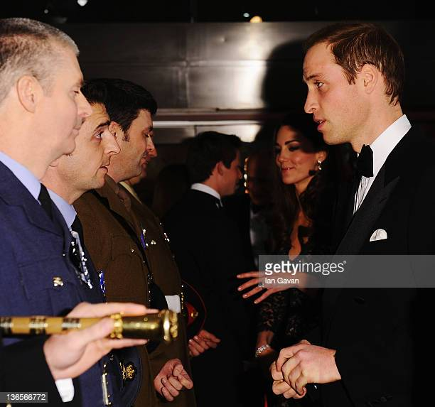 Prince William Duke of Cambridge talks with guests and dignitaries as he attends the UK premiere of War Horse at the Odeon Leicester Square on...