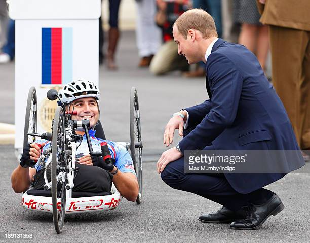 Prince William Duke of Cambridge talks with injured US veteran Corporal Charlie Lemon who is taking part in the 2013 Hero Ride on a recumbent hand...
