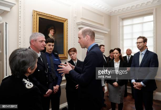 Prince William Duke of Cambridge talks with Metropolitan Police officers as he and Prince Harry host the winners of The Met Excellence Awards at...