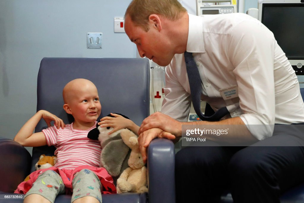 Prince William, Duke of Cambridge talks with patient Daisy Wood, 6, during a visit to the Royal Marsden hospital on May 16, 2017 in Sutton, England. The Duke of Cambridge, President of the Royal Marsden NHS Foundation Trust, visited the hospital's facilities in Sutton. During the visit, which marks 10 years since His Royal Highness became President of the centre, The Duke accompanied staff as they went about their daily activities in treating and caring for patients.
