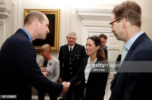 Prince William Duke of Cambridge talks with police officers including PC Shaun Cartwright who collected the Outstanding Bravery Award posthumously...