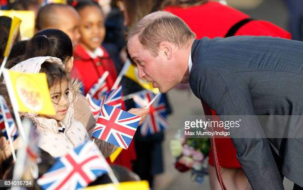 Prince William Duke of Cambridge talks with school children as he attends the Place2Be Big Assembly with Heads Together for Children's Mental Health...