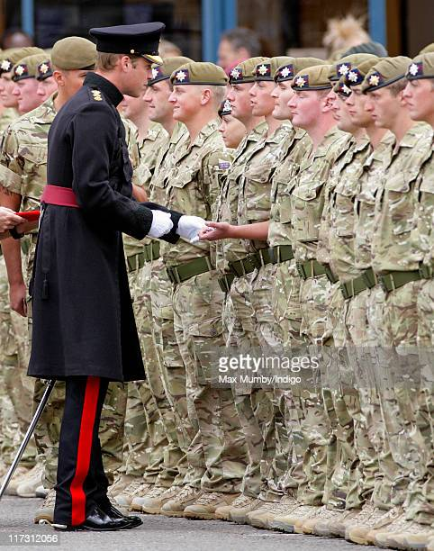 Prince William Duke of Cambridge talks with soldiers as he attends the Irish Guards Afghanistan Operational Medals Parade at Victoria Barracks on...