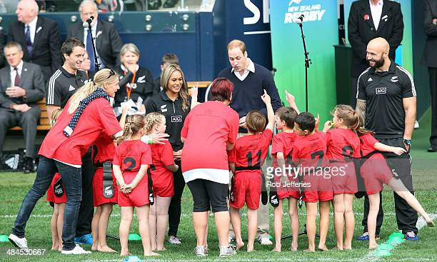 Prince William, Duke of Cambridge talks with the junior rippa rugby players while All Blacks Sevens captain DJ Forbes and Ben Smith of the All Blacks...