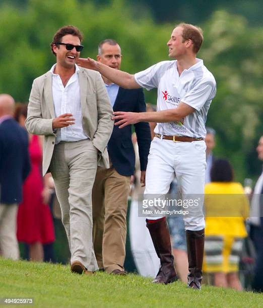 Prince William, Duke of Cambridge talks with Thomas van Straubenzee after playing in the Audi Polo Challenge at Coworth Park Polo Club on May 31,...