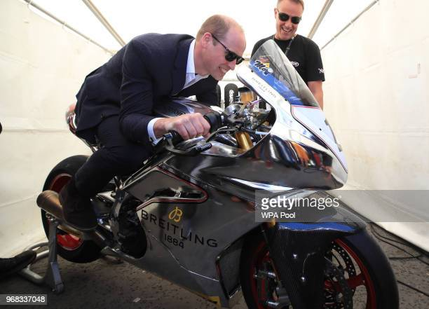 Prince William Duke of Cambridge tries out a motorbike at the Isle of Man TT on June 6 Isle of Man United Kingdom