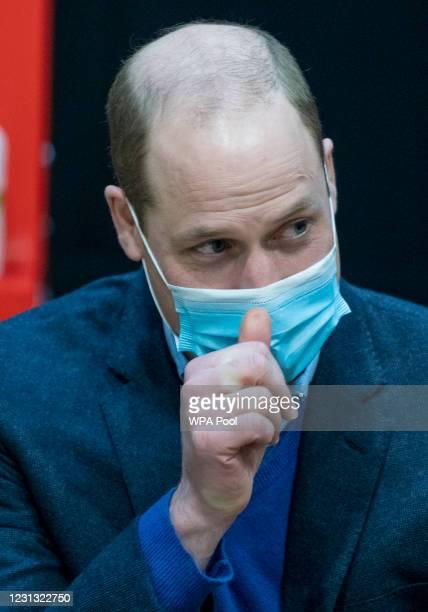 Prince William, Duke of Cambridge visits King's Lynn Corn Exchange Vaccination Centre on February 22, 2021 in King's Lynn, England. The Duke spoke to...