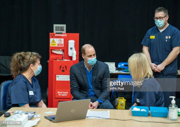 Prince William, Duke of Cambridge visits King's Lynn Corn Exchange Vaccination Centre on February 22, 2021 in King's Lynn, England. The Duke spoke to...