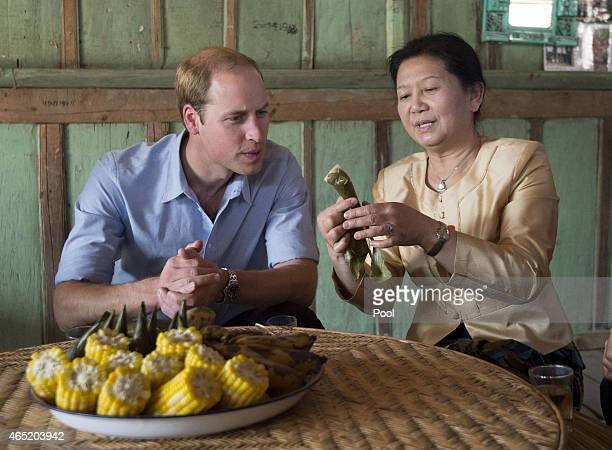Prince William Duke of Cambridge visits Mengman village where he was served with some local tea and sticky rice wrapped in banana leaves on March 4...