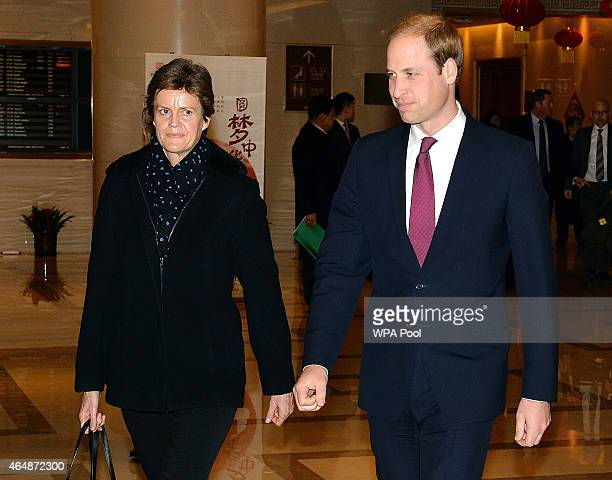 Prince William Duke of Cambridge walks with British Ambassador Barbara Woodward after arriving at Beijing International Airport from Japan on March 1...
