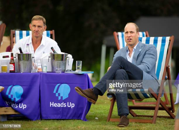 Prince William, Duke of Cambridge watches as Chelsea score with former Arsenal player Tony Adams as he hosts an outdoor screening of the Heads Up FA...