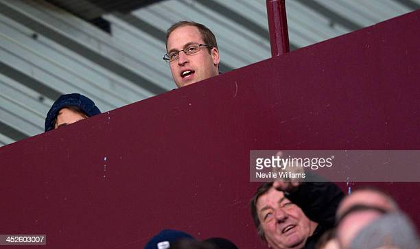 Prince William Duke of Cambridge watches the Barclays Premier League match between Aston Villa and Sunderland at Villa Park on November 30 2013 in...