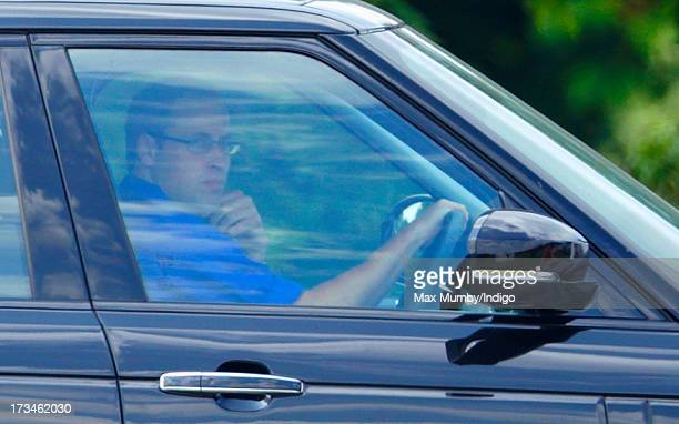 Prince William Duke of Cambridge wears spectacles as he drives himself in his Range Rover car to play in the Jerudong Trophy polo match at...