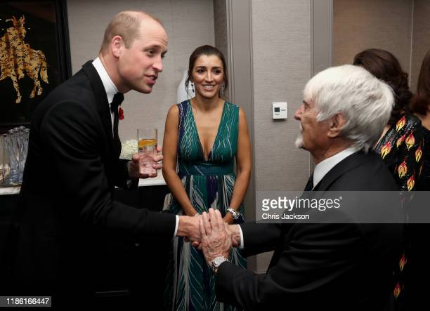 Prince William Duke of Cambridge with Bernie Ecclestone and guests as he attend the London's Air Ambulance Charity gala at Rosewood London on...