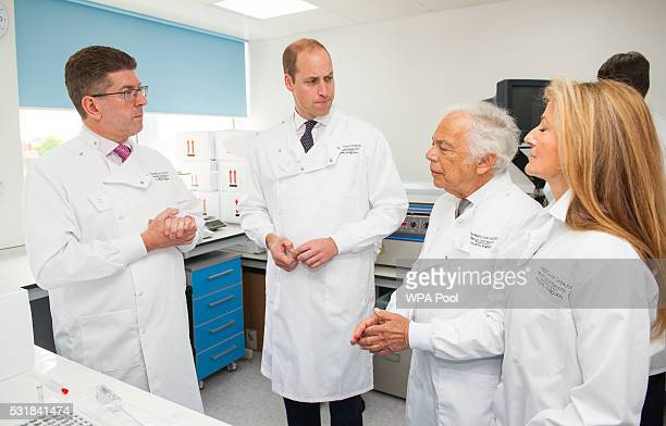 Prince William Duke of Cambridge with Consultant Medical Oncologist Professor Stephen Johnston Ralph Lauren and his wife Ricky Lauren chat during a...
