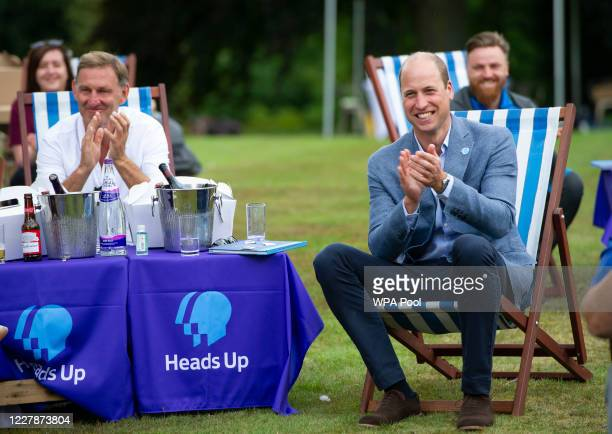 Prince William, Duke of Cambridge with former Arsenal player, Tony Adams as he hosts an outdoor screening of the Heads Up FA Cup final on the...