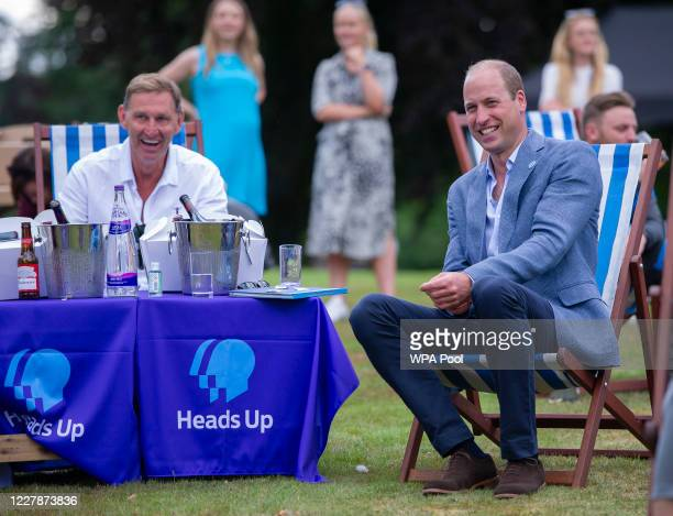 Prince William Duke of Cambridge with former Arsenal player Tony Adams as he hosts an outdoor screening of the Heads Up FA Cup final on the...