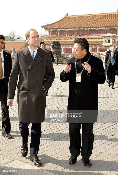 Prince William Duke of Cambridge with Mr Zhang Yaoguang the ViceDirector of Foreign Affairs at the Forbidden City as they tour the Courtyards of the...