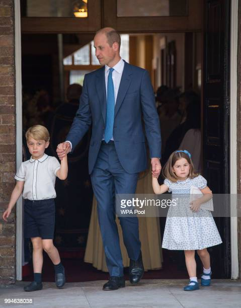 Prince William Duke of Cambridge with Prince George and Princess Charlotte depart after attending Prince Louis' christening at the Chapel Royal St...