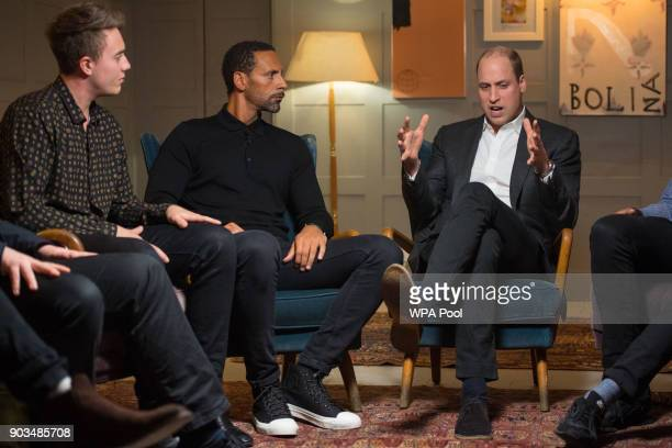 Prince William Duke of Cambridge with Rio Ferdinand and Roman Kemp during a visit to meet staff volunteers and supporters of 'Campaign Against Living...