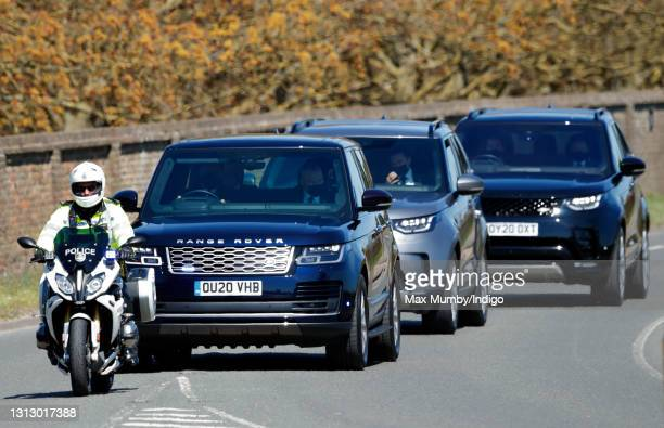 Prince William, Duke of Cambridge's and Catherine, Duchess of Cambridge's motorcade, led by a motorcycle outrider of the Metropolitan Police Special...