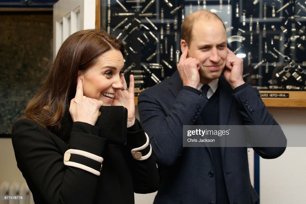 Prince William, Duke of Cambrige (R) and Catherine, Duchess of Cambridge visit Acme Whistles in Birmingham on November 22, 2017 in Birmingham, England.