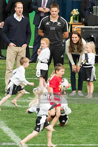 Prince William, Duke of Cambrige , Catherine, Duchess of Cambridge and All Blacks captain Richie McCaw watch a young players' Rugby tournament at...