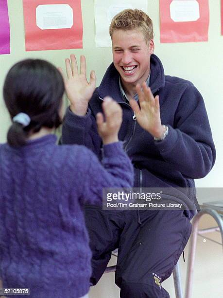 Prince William During His Raleigh International Expedition In Southern Chile Playing A Game With Nelli Munozvargas Whilst Teaching An English Lesson...