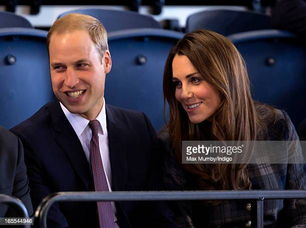 Prince William Earl of Strathearn and Catherine Countess of Strathearn watch an athletics demonstration as they visit the Emirates Arena on April 4...